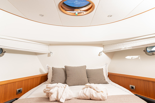 Wide view of the master bedroom of a Mulder luxury charter yacht in Mallorca