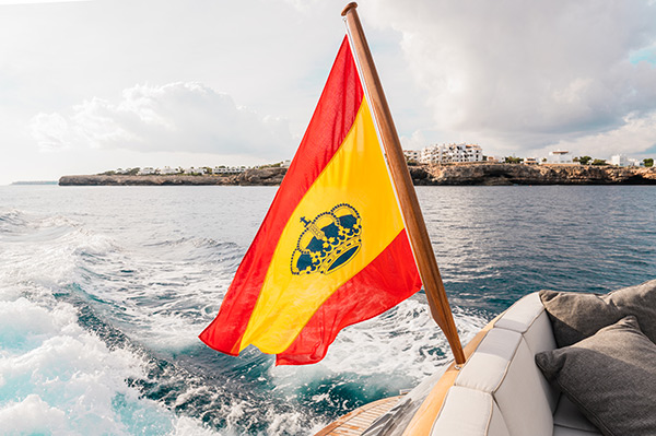Spanish flag displayed on a luxury charter yacht in Mallorca