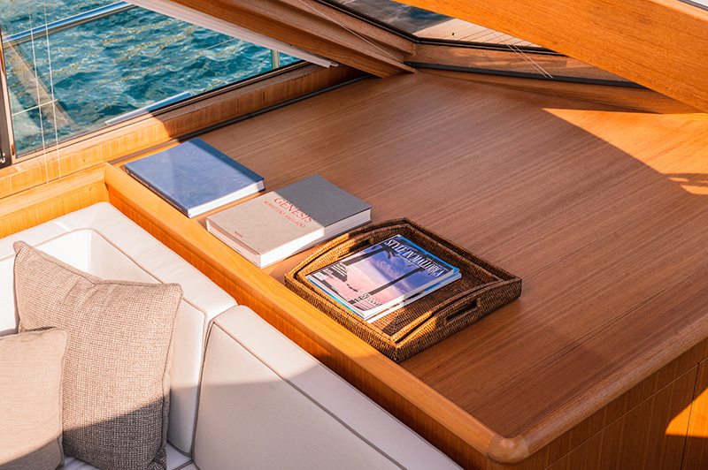 Books displayed inside of a Mulder Favorite 1500 Luxury Yacht Charter in Mallorca